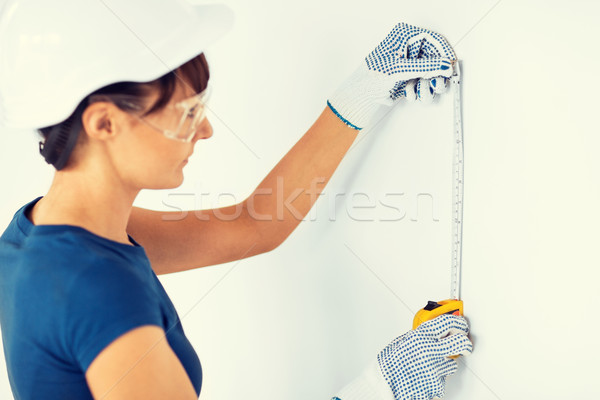 architect measuring wall with flexible ruller Stock photo © dolgachov