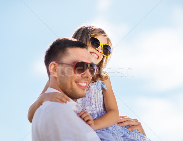 happy father and child in sunglasses over blue sky Stock photo © dolgachov