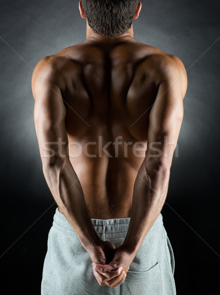 young male bodybuilder from back Stock photo © dolgachov