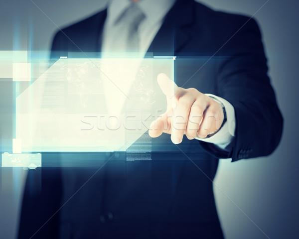 man hands with virtual screens Stock photo © dolgachov