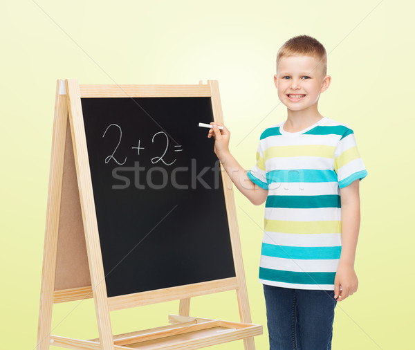 happy little boy with blackboard and chalk Stock photo © dolgachov