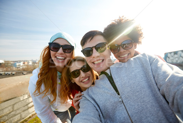 group of happy friends taking selfie on street Stock photo © dolgachov