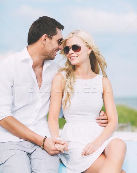 couple in shades at seaside Stock photo © dolgachov