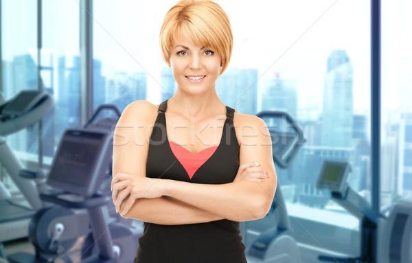счастливым женщину фитнес инструктор спортзал люди Сток-фото © dolgachov