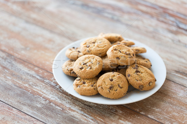 close up of chocolate oatmeal cookies on plate Stock photo © dolgachov