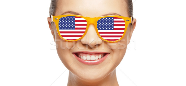 happy teenage girl in glasses with american flag Stock photo © dolgachov