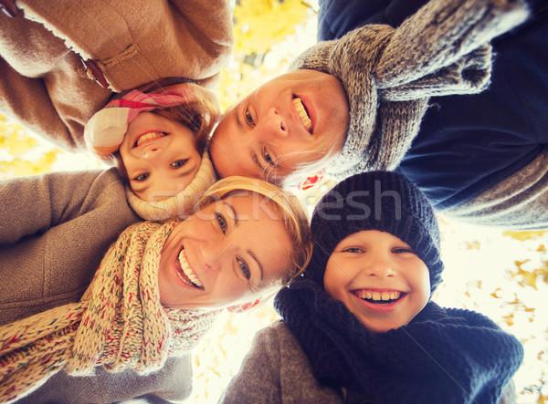 Stock photo: happy family in autumn park