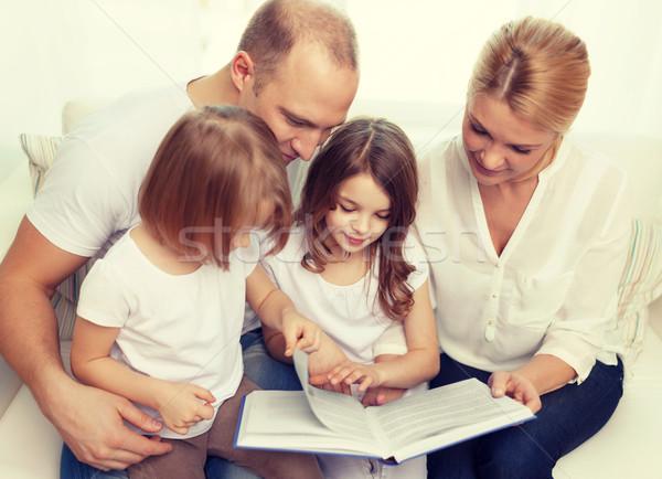 Stok fotoğraf: Gülen · aile · iki · kitap · çocuk