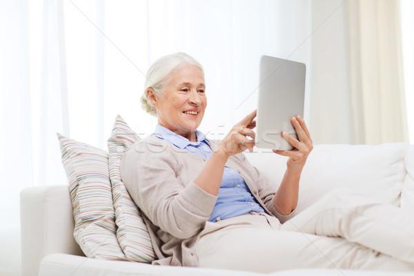 Feliz senior mulher casa tecnologia Foto stock © dolgachov