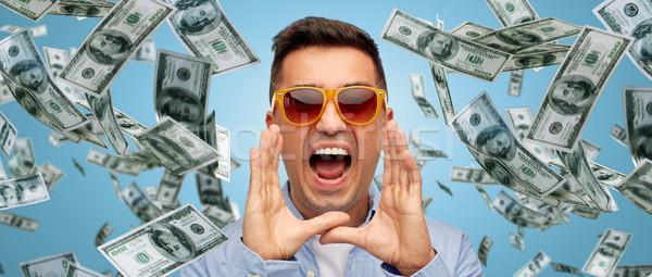 face of shouting man with falling dollar money Stock photo © dolgachov