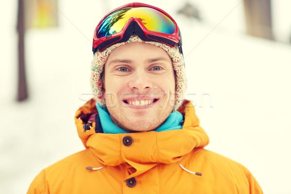 happy young man in ski goggles outdoors Stock photo © dolgachov