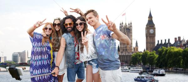 улыбаясь хиппи друзей Stick Лондон Летние каникулы Сток-фото © dolgachov