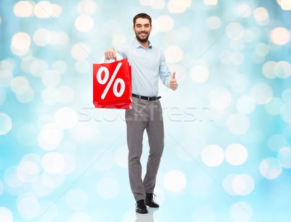 Stock fotó: Mosolyog · férfi · piros · bevásárlószatyor · kék · fények
