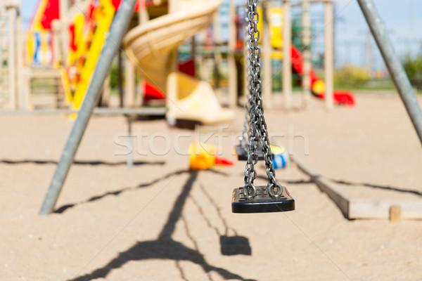 close up of swing on playground outdoors Stock photo © dolgachov