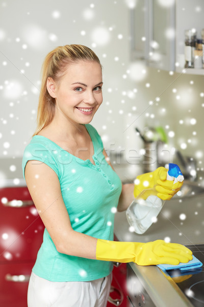Stock photo: happy woman cleaning cooker at home kitchen