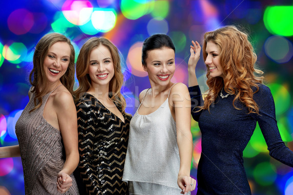 happy young women dancing at night club disco Stock photo © dolgachov