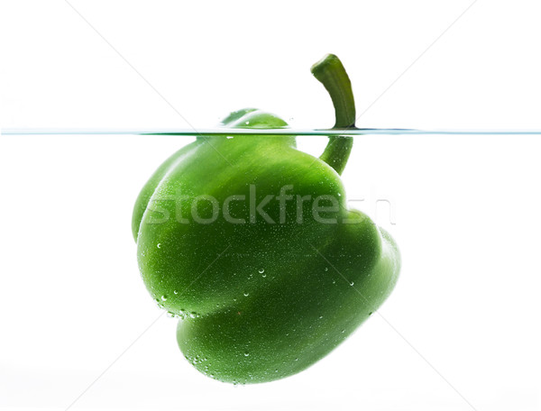 green pepper dipping or  floating in still water  Stock photo © dolgachov