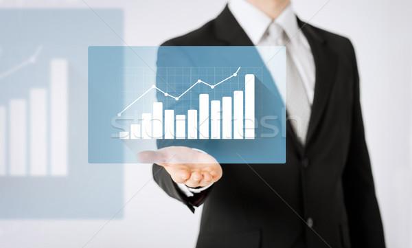 close up of man hand showing diagram chart Stock photo © dolgachov