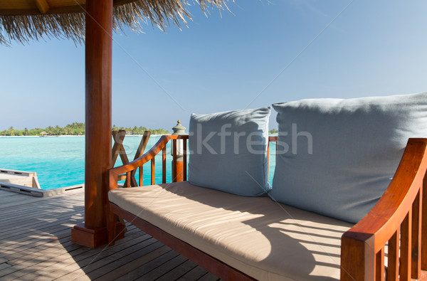 patio or terrace with canopy and bench on beach Stock photo © dolgachov