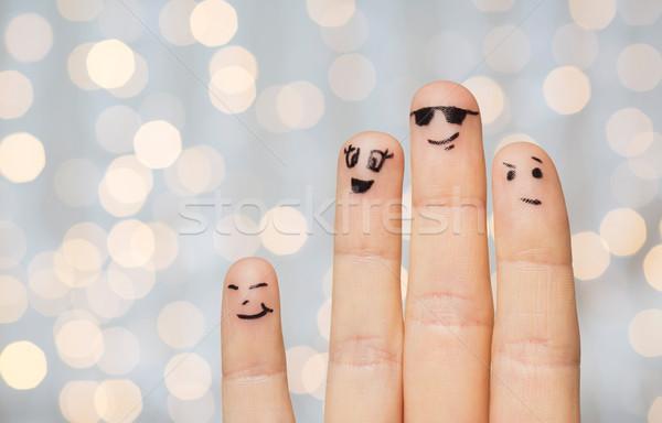 Quatre doigts visages geste Photo stock © dolgachov