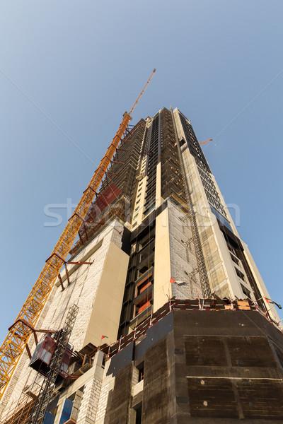 building of skyscraper in Dubai city Stock photo © dolgachov