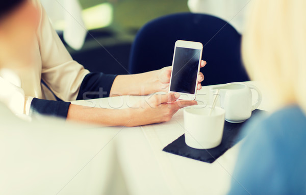 close up of women with smartphone at restaurant Stock photo © dolgachov