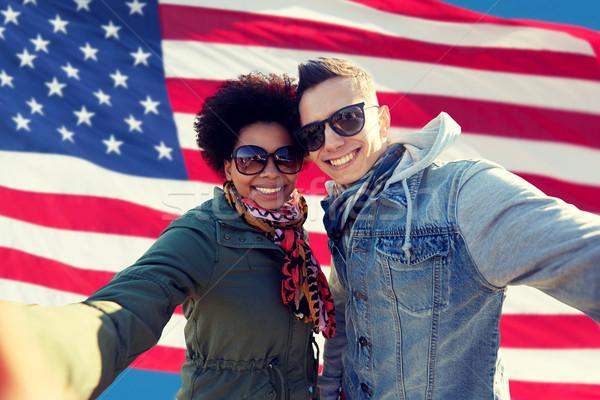 happy couple taking selfie over american flag Stock photo © dolgachov