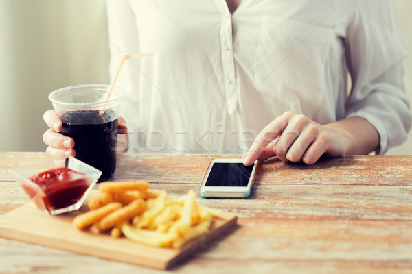 close up of woman with smart phone and fast food Stock photo © dolgachov