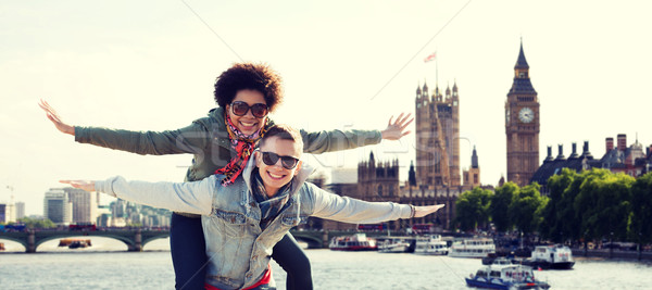 happy teenage couple having fun over london city Stock photo © dolgachov