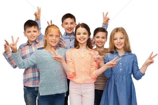 happy children showing peace hand sign Stock photo © dolgachov