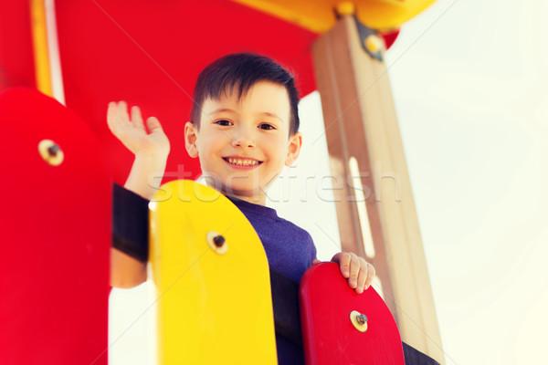 Felice piccolo ragazzo climbing bambini parco giochi Foto d'archivio © dolgachov