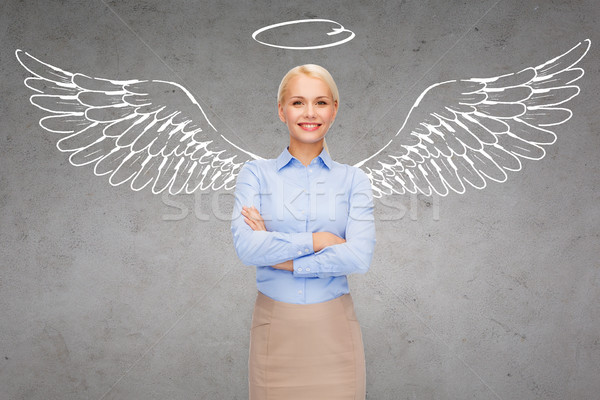 happy businesswoman with angel wings and nimbus Stock photo © dolgachov