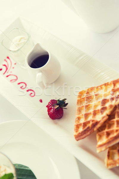 close up of waffles on plate at breakfast table Stock photo © dolgachov