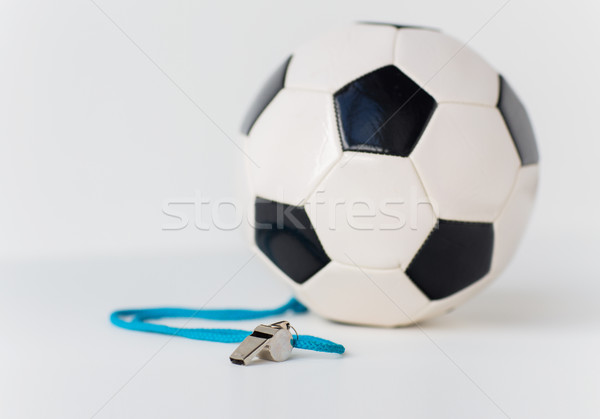 close up of football or soccer ball and whistle Stock photo © dolgachov