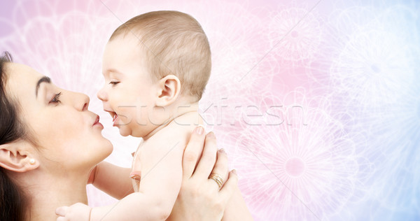 happy mother kissing adorable baby Stock photo © dolgachov