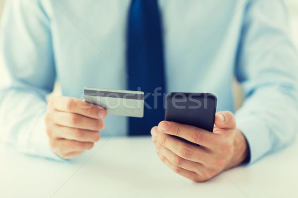 Foto stock: Mãos · cartão · de · crédito · negócio · tecnologia
