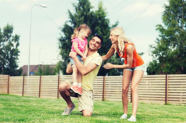 Boldog család ölel kint család boldogság örökbefogadás Stock fotó © dolgachov