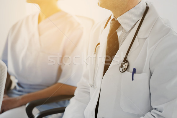 Stock photo: close up of happy doctors at seminar or hospital