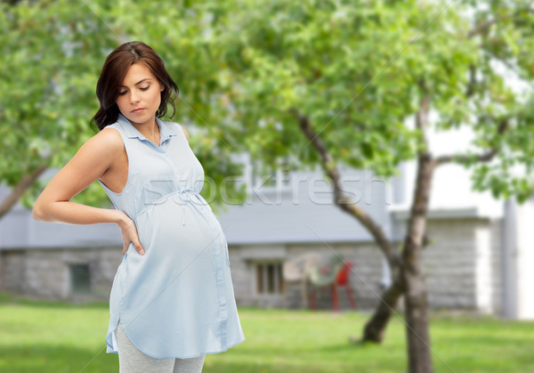 pregnant woman with backache Stock photo © dolgachov