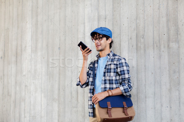 man using voice command or calling on smartphone Stock photo © dolgachov