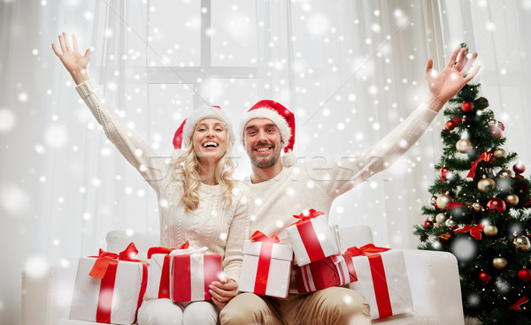 Stock photo: happy couple at home with christmas gift boxes