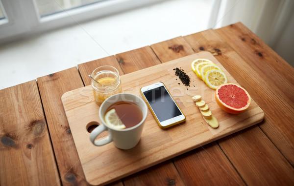 Fincan limon çay bal zencefil Stok fotoğraf © dolgachov