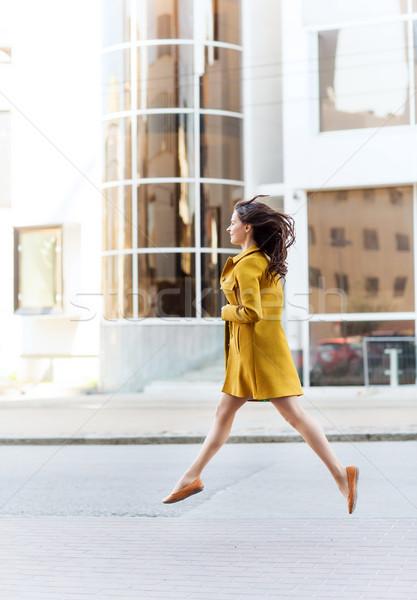 happy young woman or teenage girl on city street Stock photo © dolgachov