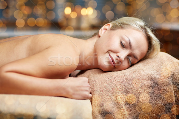young woman lying on massage table in spa Stock photo © dolgachov