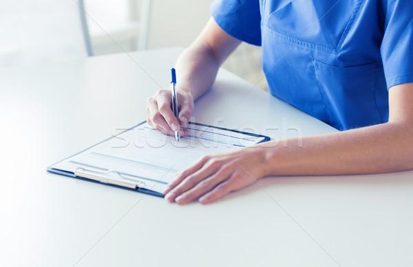 Foto stock: Médico · enfermera · escrito · portapapeles · medicina