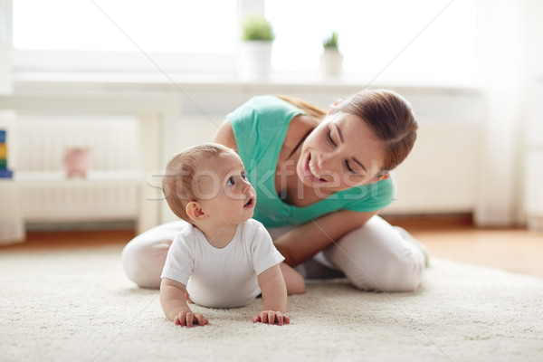 happy mother playing with baby at home Stock photo © dolgachov