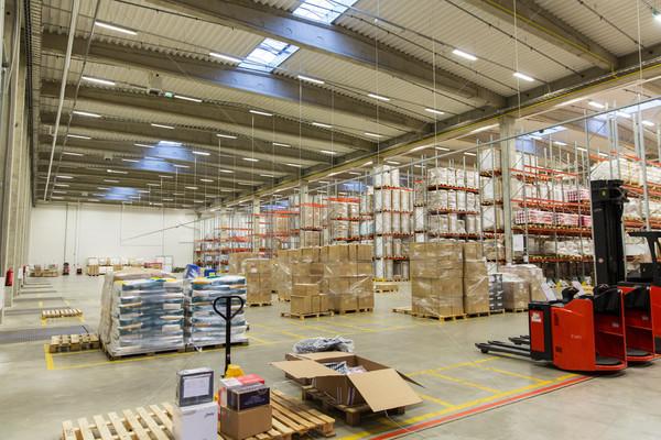 forklift loader and cargo boxes at warehouse Stock photo © dolgachov