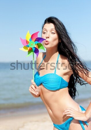 happy woman with pinwheel over blue sky and sea Stock photo © dolgachov