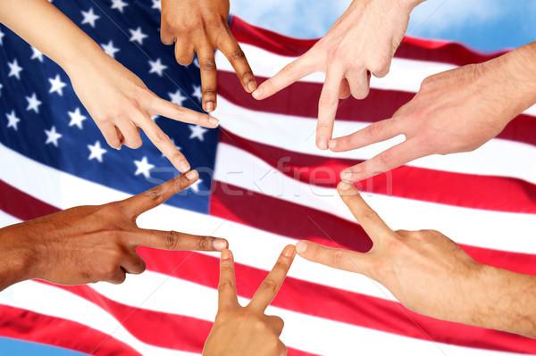 group of international people showing peace sign Stock photo © dolgachov