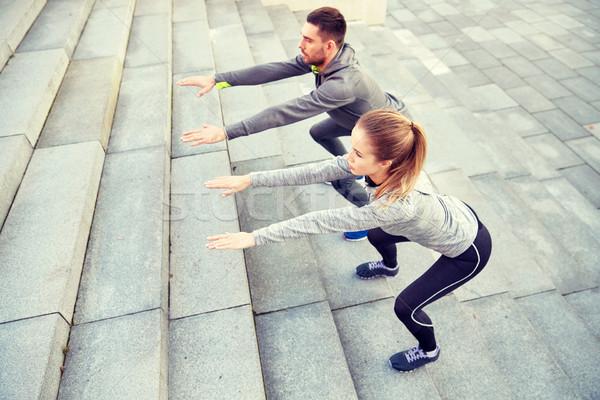Pár figyelmeztetés lépcsősor fitnessz sport emberek Stock fotó © dolgachov